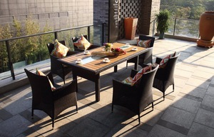 Outdoor patio furniture metal frame dining table with wood top.