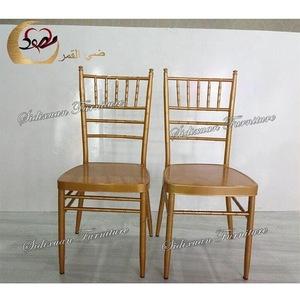 Armless stacking chiavari chairs used hotel wedding